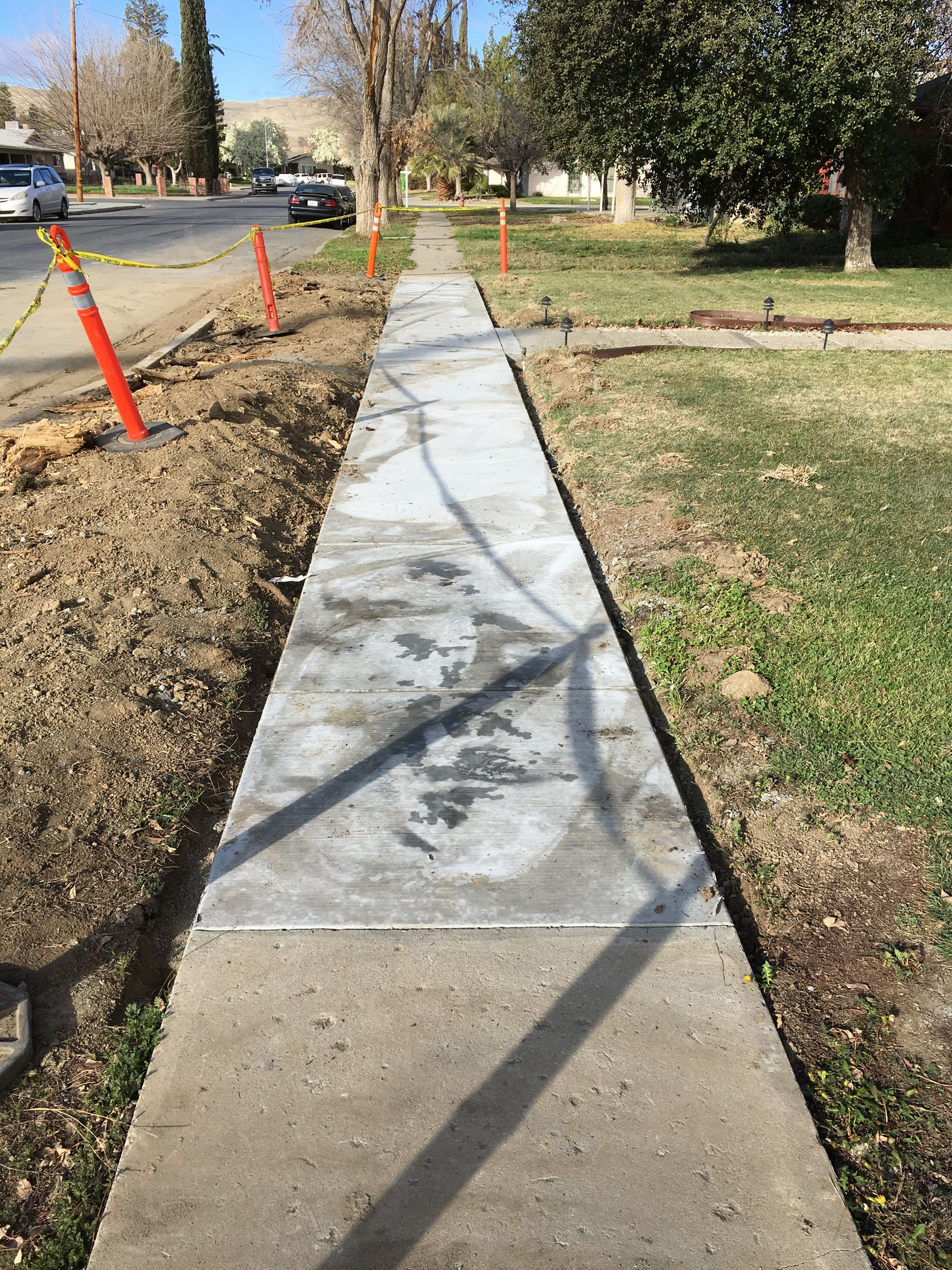 434 Madison new sidewalk and concrete drying
