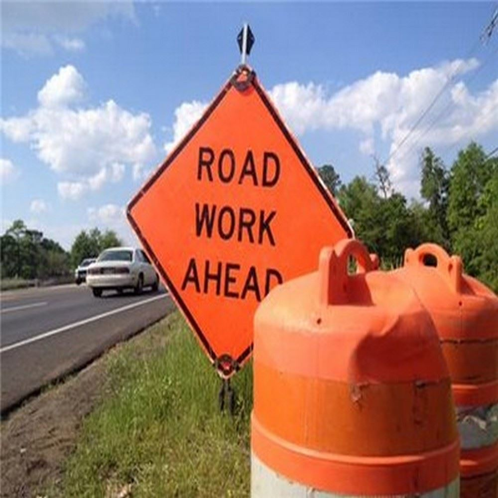 road work sign near a road